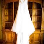 maidenwood-weddings-and-events-Fireside Room - Dress Hanging on the Bookshelf